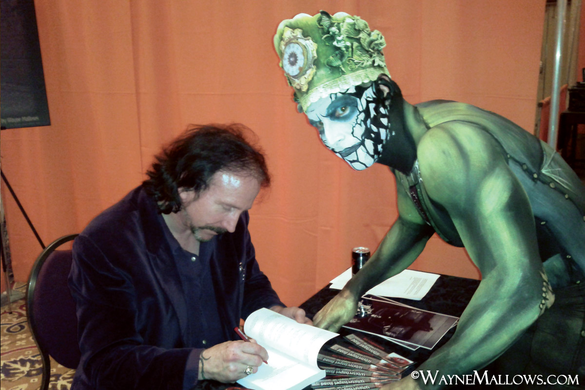 Book signing at an event. Amazing body paint!